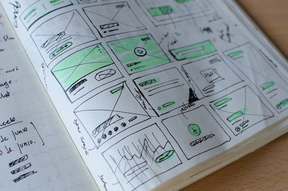 content designer's notebook with mockups