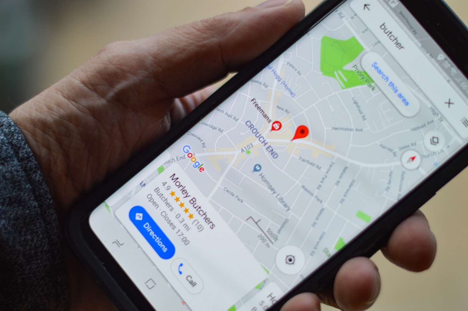 person holding phone with google maps open